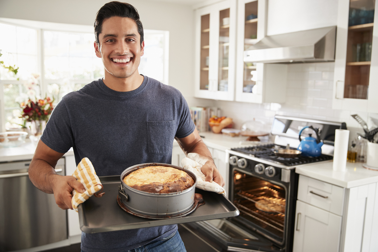Hispanic Cook Smiling in the kitchen